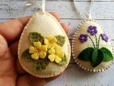 Felt easter decoration - felt egg with wild spring flowers / choice of design Listing is for 1 ornament Size of my decorated eggs is about 2 1/8 x 2 5/8 inch (5,3 x 6,5 cm) This is size of felt egg without hanging loop Handmade from wool blend and wool felt This item is made to order