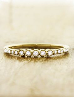 The Elza is sweet yet far from simple wedding band with diamonds studded  throughout a gold band. by Ken & Dana Design.