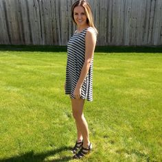Our striped jersey knit dress features a cut-out back and made with a soft/stretchy material. Layer with your favorite jacket now, then wear all summer long! 95% Polyester, 5% Spandex.