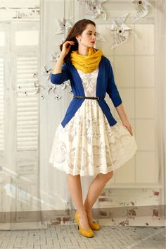 From the ModCloth #stylegallery:  Beautiful outfit: the white dress paired with the blue and yellow accents works wonderfully.