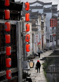 Artist: unknown medium: photography date: unknown This picture contains both Chinese architecture and Chinese calligraphy. When I think of Chinese buildings, I think of the roof edges curving up, which it does that. Also, there are decorations hanging down with calligraphy on it, and calligraphy has different meanings and it
