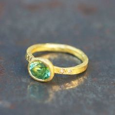 Beautiful ring 'Feelings' engraved matt gold set with a green EMBLÉMATIQUE and diamonds, artisanal…