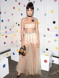 Bella Hadid, the face of Dior beauty, proves that you can rock the runway in real life. The model wore look 49 from Maria Grazia Chiuri's first Dior collection, and even got new bangs to mimic the runway look.