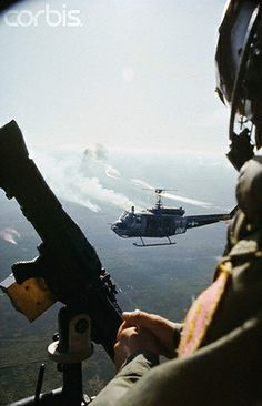 1965 - A view over the shouder of a US helicopter gunner during a Delta dawn assault