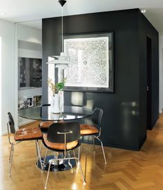 Renovated Flat in Moshe Safdie's Habitat - Dwell - Vintage table surrounded by Eames DCM chairs topped with custom-made leather cushions. PHS pendant lamp by Poul Henningsen for Louis Poulsen. Black Walls, White Walls, Interior Architecture, Interior And Exterior, Dining Area, Dining Chairs, Dining Room, Eames Chairs, Piece A Vivre