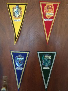 Harry Potter themed door decs for RAs. Pennants and ribbon bought from hobby lobby, photos printed at cvs. A little time consuming but totally worth it :)