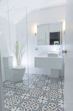 tile flooring for bathrooms this beautiful white bathroom design has combined a modern white vanity unit and toilet with a more traditionally inspired pattern tiled floor marble tile bathroom floor id Patterned Bathroom Tiles, Bathroom Makeover, Shower Room, Small Bathroom, Modern Bathroom, Bathroom Renovations, Amazing Bathrooms, Bathroom Decor, Bathroom Inspiration