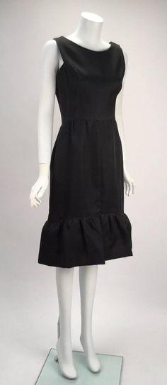 For Sale on - Balenciaga black silk couture cocktail dress. Sleeveless with large ruffle hem. The dress fastens with a side zipper and hook-n-eye/ snap closure. Mod Fashion, 1960s Fashion, Timeless Fashion, Vintage Fashion, Christian Dior, Balenciaga Vintage, 1960 Dress, Fairytale Dress, Autumn Fashion 2018