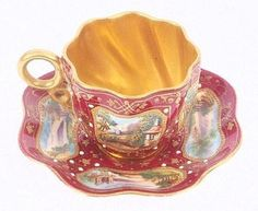 A Coalport miniature tea cup and saucer, painted: by kasey