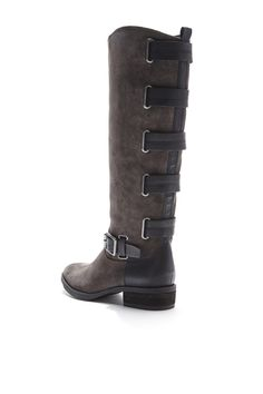 Rich riding boots with a mini stacked heel, side zipper, rounded toe, and the best part: The straps that decorate the back.