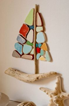 Beach pottery and driftwood sailboat