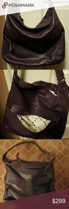 KATE SPADE HOBO BAG AUTHENTIC KATE SPADE LEATHER  DARK PURPLE HOBO BAG ONE OUT SIDE POCKET  THREE INSIDE POCKETS  GREAT CONDITION  ONLY FLAW AS SEEN IN PIC THERE IS A STAIN ON THE LINING THAT NO ONE WILL SEE ! VERY CLEAN  12.5 X 14 REALLY ROOMY Kate Spade  Bags Hobos