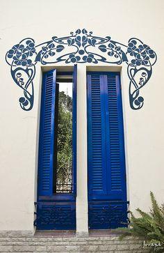 Art Nouveau stencil on window