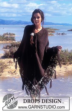 Ravelry: 64-23 Poncho with crocheted flower squares and fringes pattern by DROPS design