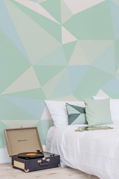 Don't stress over picking one colour for your walls when you can have a spectrum of colours. This wallpaper design is a geometric wonder, full of abstract diamonds and a beautiful array of mint greens. Ideal for modern bedroom spaces.
