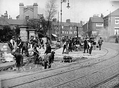 Road layers hard at work on Snow Hill. This road was the main route between Stoke and Hanley. The twin tramlines are a clear indicator that this was a busy route.  The road sweeps to the right at the top of the picture and passes Shelton Church before dropping down through Victoria Place. 1914