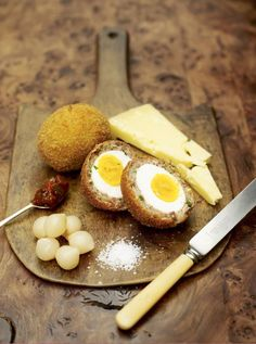 Scotch egg with cheese, onions and English mustard