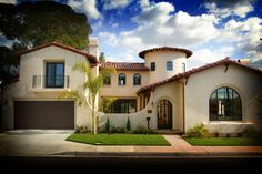 Spanish Colonial. 1 1/2 story w/rear tower