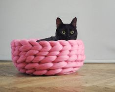 Anna Mo, whose chunky knitting has been featured before on Bored Panda, is back with some new knit items: chunky knit pet beds! The cat model sells for 81 USD, while the dog model goes for 70 USD; both are made from 23 microns merino wool and shipped from Ukraine.