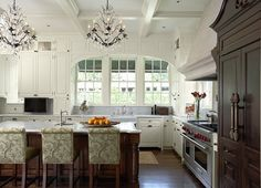 Decorative bar stools and chandeliers add to this delightful remodel in historic St. Paul. (houzz.com)