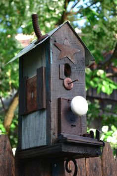 Love this birdhouse using junk!