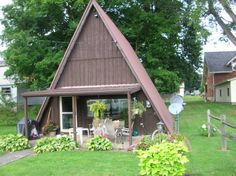 This itty bitty Ohio one-bed A-frame has only 640 square feet, but there's plenty of room for a colorful garden. Kick back on the porch after a long day of work and watch the neighbors go by.  Location: Perrysville, OHSquare Feet: 640Price: $54,000   - HouseBeautiful.com