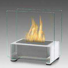 Sleek and stylish, the Paris Biofuel Fireplace by Eco-Feu makes any space streamlined and impressive. The polished steel and matte black contrast to make Paris an att. Biofuel Fireplace, Ethanol Fireplace, Foyers, Foyer Mural, Tabletop Fireplaces, Ethanol Fuel, New Technology Gadgets, Long Lights, Traditional Fireplace