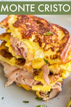 Classic Monte Cristo Sandwich that will become your favorite breakfast sandwich! Loaded ham and cheese between bread slices generously dredged in an egg mixture and cooked until bread slices are crispy. #valentinascorner #montecristo #breakfast #sandwich #sandwichrecipe #monte