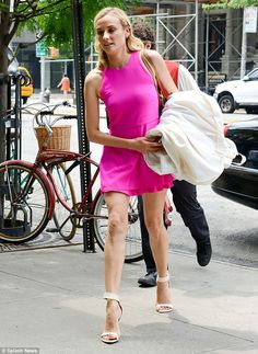 Pretty in pink! Kruger showed off her svelte legs in a hot pink dress with a short skirt