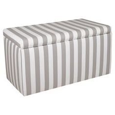 """Striped storage bench with a pine wood frame and foam cushioning. Handmade in the USA.   Product: Storage benchConstruction Material: Solid pine, polyurethane, polyester foam and twillColor: Storm and whiteFeatures:  Handmade in the USALift-off lidDimensions: 18"""" H x 34"""" W x 17"""" DCleaning and Care: Spot clean only"""