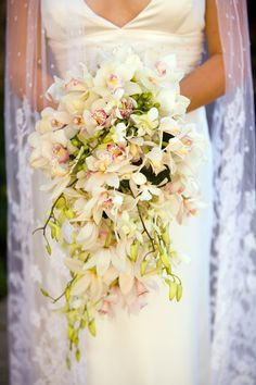 A gorgeous hang bouquet of Orchids. different greenery though, like maybe dark dreen.. but i love it!