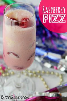 Raspberry Fizz - A creamy concoction of fresh raspberries, sherbet and ice cream mixed with fizzy lemon-lime soda or champagne. Perfect for New Year's Eve or Valentine's Day!