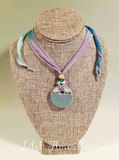 Lavender Sea Flower Ceramic Necklace - by Lilah Flores Creations: This handmade light blue and lavender stoneware creation was inspired by the beautiful colors and various kinds of sea flowers that can be found in the ocean depths. This reduction fired ceramic necklace would make a lovely addition to your jewelry collection or a fantastic gift for friends, family members, bridesmaids, coworkers, and more!