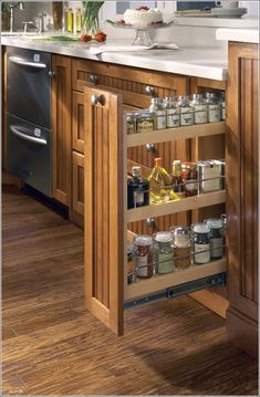 Check out these creative spice storage ideas for small kitchens. Plus, get a free printable spice storage chart & learn which spices to use in your dish. Pull Out Kitchen Cabinet, Hidden Kitchen, Kitchen Cabinet Styles, Kitchen Rack, Kitchen Cabinet Organization, Diy Kitchen, Kitchen Storage, Kitchen Cabinets, Organization Ideas
