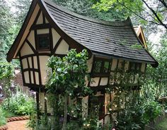 [Image: Quirky Tudor-style home overgrown with rose bushes.] Via: http://www.flickr.com/photos/oobrien/508225116/