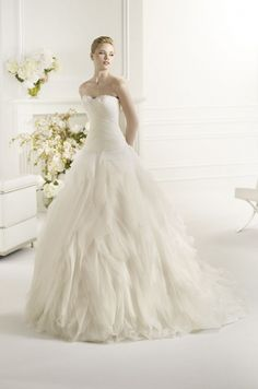 Strapless gown with cut tulle and organza layered skirt.