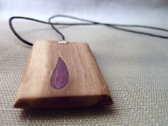 Necklace with amaranth and olive wood pendant. Modern inlaid amaranth drop in…