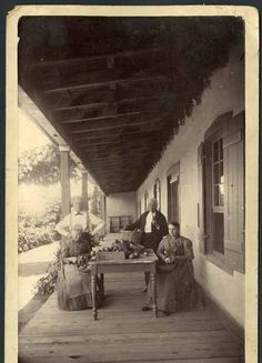Adolph Bandelier and his father with Josephine Bandelier on left and Fanny Lambelet at the Kaune residence (now Sherwood Gallery), 1890, Santa Fe, New Mexico. Photo by Charles Lummis. Palace of the Governors Photo Archives 009167.