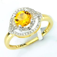 This alluring citrine diamond gemstone ring has a  round cut citrine main stone in a prong setting. There are round cut diamonds in prong settings with a total weight of 0.24cts. The color and clarity are H/I and I1/I2 respectively. $338.00