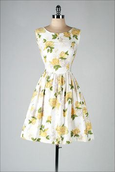 1950s dress yellow roses. I absolutely adore this classic style. I can picture both of my beautiful grandmothers wearing this dress!