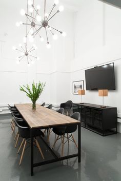 wood looks nice with the concrete floors - prefer white chairs. for common area and conference room