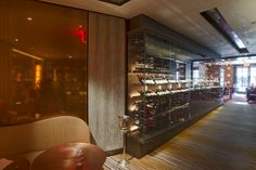 Spivak Architects - bronze wall at The Mark Restaurant by Jean-Georges