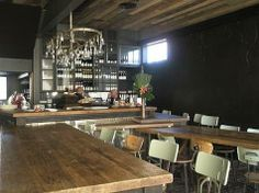 communal tables --> Gjelina in Los Angeles : Remodelista Cafe Restaurant, Restaurant Design, Restaurant Interiors, Delicious Food Image, Industrial Stool, Industrial Chandelier, Communal Table, Los Angeles Restaurants, Wood Ceilings