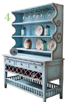 Limited Edition Southwest Style Buffet and Hutch by Raymond Waites  Elizabeth Interiors 409 Brant St Burlington  www.elizabethinteriors.com. I could paint my antiqued white hutch this color.