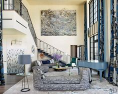 A monumental Anselm Kiefer painting presides over the opposite end of the living room, where a Vladimir Kagan sofa (clad in an Armani/Casa fabric) from Ralph Pucci International is paired with a cocktail table from Jean-Louis Deniot's collection for Jean de Merry