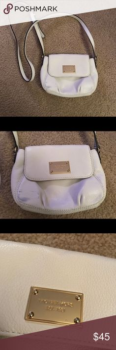 Michael Kors White Crossbody White Crossbody Good Used Condition with small discoloration on be front corner (shown in picture) Small Scratch on the Michael Kors logo (shown in picture)  Make Offer Perfect small size for concerts or summer dates, etc. Michael Kors Bags Crossbody Bags