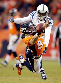 Wes Welker #83 of the Denver Broncos attempts to make a catch as Darius Butler #20 of the Indianapolis Colts defends during a 2015 AFC Divisional Playoff game at Sports Authority Field at Mile High on January 11, 2015 in Denver, Colorado. (January 10, 2015 - Source: Ezra Shaw/Getty Images North America)