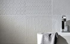 A beautiful looking tile that features a mix of different embossed patterns. Available in soft white or soft grey 300X300 #feature #tiles #design
