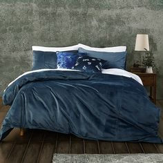 Elevate your bedroom decor with the luxurious design of this MM Linen Velvet Indigo Duvet Cover Set. This beautiful set is crafted in lush and shimmering velvet, with a rich solid color finish that will lend a mesmerizing texture to your bed.