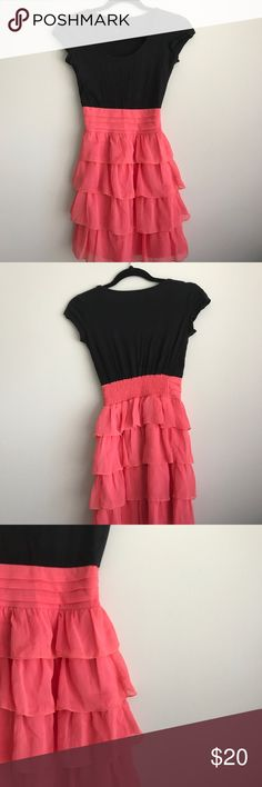 Black and pink ruffled dress Size XS. The top is black and the bottom half is pink and ruffled Dresses